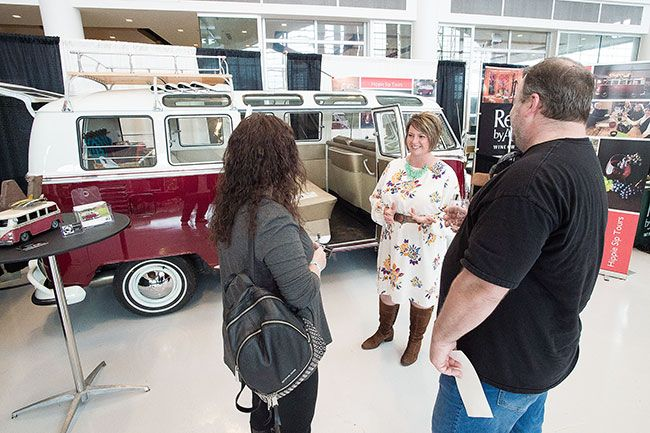 Marcus Larson / News-Register## At the 2018 Sip! Friday, Crystal Laridon talks with Jason Jones and Angie Wall about her companies  hippie themed  wine tours, traveled in a remodeled 1967 VW Bus.