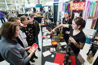 News-Register file photo##At the 2017 Sip, crowds enjoy food, wine and art.