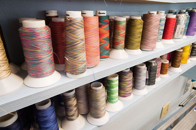 Marcus Larson/News-Register##Large spools of thread await use on Bobbie Abernathy-Bebereia's long-arm quilting machine.
