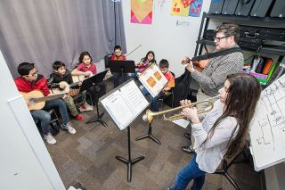 "Marcus Larson/News-Register##Youth Mariachi band members, left to right, Jose Andrade, Luis Andrade, Erick Alberto, Johnathan Hernandez, Yareli Barcenas, Alejandro Chavez, teacher Ben Rice and Jade Andrade practice a song called ""Volver, Volver."""