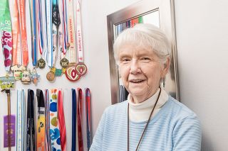 Rusty Rae/News-Register ## Although it's been less than a decade since she started walking for exercise, Ruth Mendes da Costa has collected dozens of medals for finishing 5K, 10K and half-marathon events.