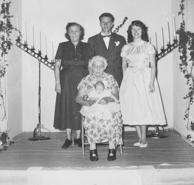 ## Bandon, 1957: Five generations of my mother's family, with me on my great-great grandmother's lap. My relatives inspire the fictional characters for my novels.