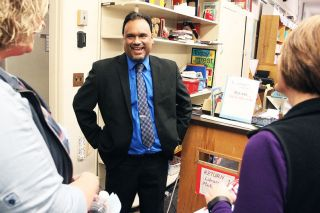Rockne Roll/News-Register##Dayton superintendent candidate Jon Mishra chats with community members during an open house at Dayton Grade School on Thursday, March 16. He is one of two finalists who will be reinterviewed tonight.
