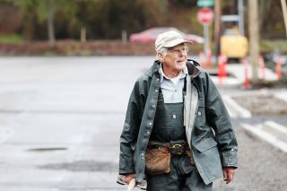 Rockne Roll/News-Register##Doug Cruikshank walks back after scooping a load of gravel at a Habitat for Humanity homesite in McMinnville. He usually volunteers Tuesdays, Thursdays and Saturdays.