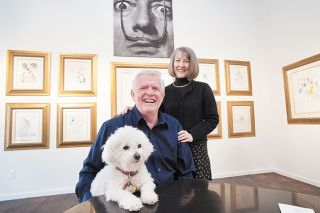 Marcus Larson/News-Register file photo##Gary and Signe Lawrence pose with Juliette, their Bichon Frise, in the museum room they created for the Salvador Dali show. Photo taken in 2013 just before the show opened.