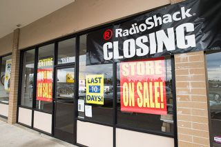 Marcus Larson / News-Register##Banners denoting the closure and clearance sale are on display at the McMinnville RadioShack store.