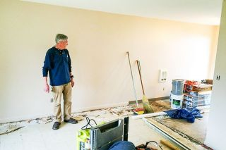 Chris Lehman/OPB##Landlord Mark Bidwell examines repairs to a unit at the Keizer apartment complex he owns.