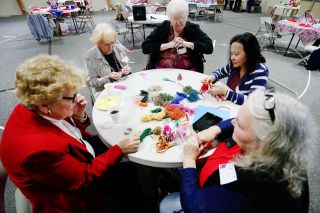 Rockne Roll/News-Register##Joanne Walker, Dorothy Parker, Darlene Grauer, Lisa McRae and Sharyl Michael make stocking cap ornaments during the FCE Spring Festival.