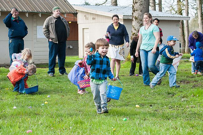 Marcus Larson/News-Register##Zane Tilden cheers with excitement after finding another egg during the  Easter event in Yamhill s Beulah Park.