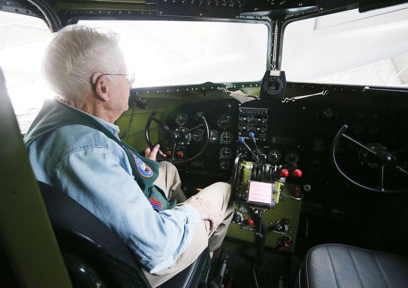 Rockne Roll/News-Register## Evergreen docent Dick Wood sits in the cockpit of a Douglas DC-3, the same DC-3 Wood worked on as a mechanic with United Airlines. One of his fellow docents, the late Jack Schlemer, piloted the same plane.