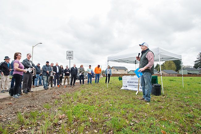 Marcus Larson / News-Register##Darrick Price, president of Fishbone Construction and the nonprofit Housing People, details plans for a new subdivision in Dayton during a groundbreaking ceremony Tuesday.
