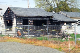 News-Register file photo##Council members say the burned-out house must go.