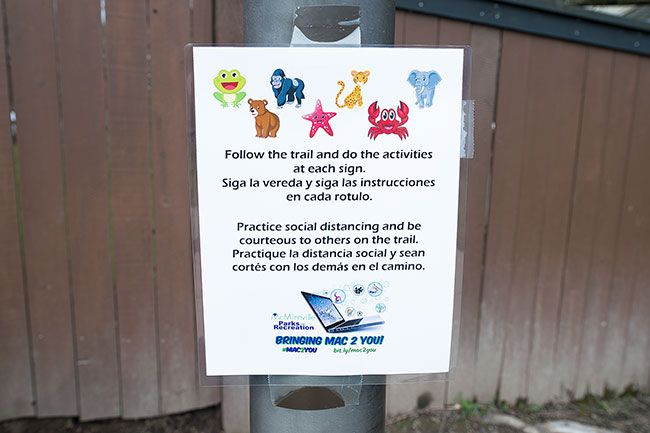 Marcus Larson / News-Register##Signs posted lalong the greenway trail in West McMinnville encourage youngsters to run in place, do jumping jacks and otherwise act like animals.