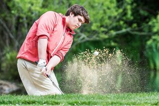 Marcus Larson/News-Register##McMinnville's Michael Martinoff escapes a sand trap on the second hole at Michelbook Country Club during Tuesday's Class 6A Greater Valley Conference tournament.