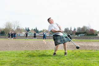 "News-Register file photo/Marcus Larson##Highland Games competitor Ray Mabey practices one of the ""heavy"" events, which require strength, stamina and skill. He won't be competing this weekend; rather, he'll organize the competition, since he's the athletic coordinator for the McMinnville Scottish Games."