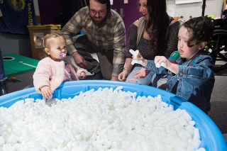 Marcus Larson / News-Register##River Gilmore and her brother Maverick dig through a wading pool full of foam peanuts, searching for colored eggs.