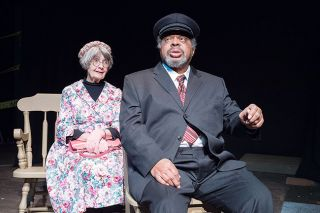 Marcus Larson/News-Register file photo##Josiah Phillips on the Gallery Theater stage as Hoke, driving the cantankerous Miss Daisy (Sharon Morgan) to the grocery store.