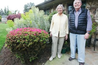 Rockne Roll/News-Register##Edie and Don Rissberger-Stow, in front of their home on Northwest Pinehurst Drive in McMinnville. The couple's flower-filled landscaping won them Yard of the Month honors.