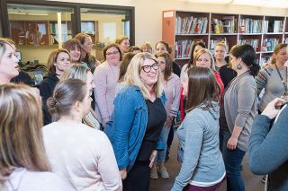 News-Register file photo##Former Wascher Elementary School principal Kourtney Ferrua, center, is congratulated after being named Oregon Elementary Principal of the Year in 2019.