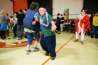 Rockne Roll / News-Register##Makhi Blackcrow cuts a rug while dressed to fit in with the prom's luau theme.