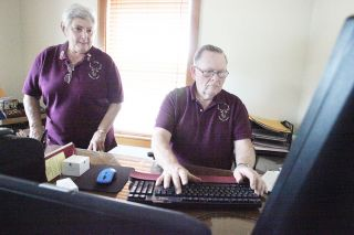 Rockne Roll/News-Register##Elks Lodge 1283 Exalted Ruler Donna Gentile, left, and Secretary Gary Farmer draft letters in the lodge's new office at 1945 N.E. Baker St. The lodge sold its old building and is looking for a permanent home.