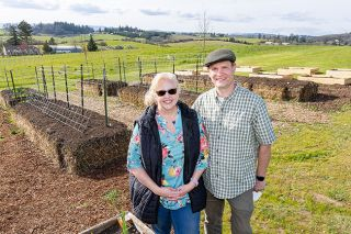Marcus Larson/News-Register ##  Mary Kathleen Drew and her husband, Bill, moved to rural Yamhill last yard and are using straw bales to improve their garden soil.