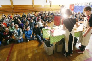 Rockne Roll / News-Register##Yamhill-Carlton Intermediate School fifth-graders watch the baking demonstration.