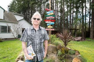 Marcus Larson/News-Register ## Mike Paull poses for a portrait in his front yard, which is decorated with sculptures and other decorative items. Paull has been a carpenter, a treatment plant operator and a coffee shop owner; he will always be a writer of poetry and prose.