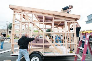 News-Register file photo##Derin Williams, whose Shelter Wise company specializes in tiny houses, took part in a build at the Casa Verde festival in McMinnville in 2013.