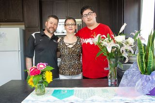 Rusty Rae/News-Register ## Christian Ramirez loves living in the new Habitat home with his parents, Gerardo Ramirez Lopez and Maria Guadalupe Leon Lamus. Their kitchen is filled with flowers presented for his mother's birthday, which was celebrated at the same time they moved in.