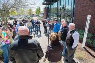 Marcus Larson / News-Register##Rotarians, city officials and others gather for the dedication of the peace pole Friday at McMinnville[ s Civic Plaza.
