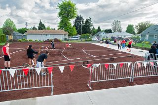 Marcus Larson/News-Register##McMinnville's Grifin Williams tosses the shot in the Grizzlies' new shot put area during the McMinnville Invitational April 22.