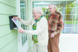 Marcus Larson/News-Register##Yvonne and Ted Phillips volunteer to deliver newsletters twice a week at Hillside Retirement Community. They moved there two years ago and love it.
