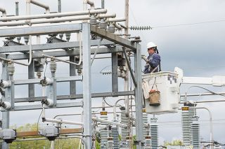 Marcus Larson / News-Register##McMinnville Water & Light worker Jake Faulkner uses a bucket truck to inspect a damaged insulator at the Booth Bend substation. Workers suspected a flock of birds might be responsible for cutting power to half of Mac.