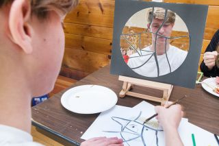 Marcus Larson/News-Register##Dylan Gunther works on his Picasso-style self-portrait during the Y-C Night of the Arts fundraising event.