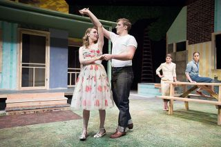 "Marcus Larson/News-Register##Hal Carter (Daniel Bradley) slow dances with Madge (Analeasa Fisher) in Linfield's production of ""Picnic."""