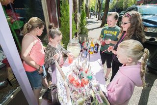 Marcus Larson/News-Register##Customers Brynn McManus, Olivia Coulter and Rylie McManus shop at Margo White and Daphne McManus'