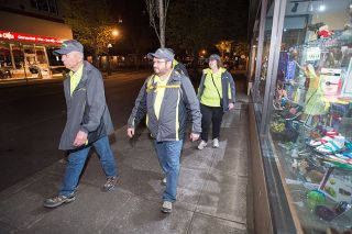 Marcus Larson/News-Register##Mac City Pastors conduct their first patrol Friday night. From left, Terry Armstrong, Dennis Nice, Nancy