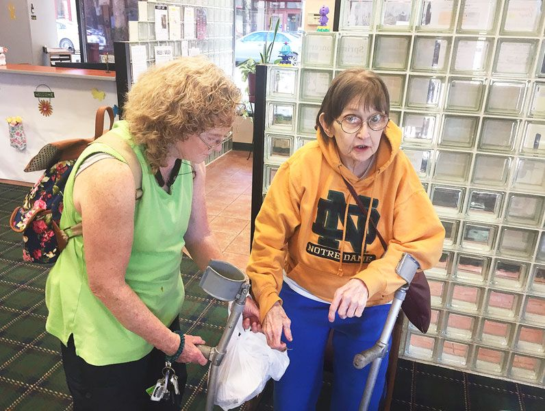 Steve Bagwell / News-Register##Sidne Grace of Otis visits the newspaper to rave about the treatment she got at the local hospital. Providing an assist is 45-year friend Catherine Miller Manning of Ellensburg, Washington.