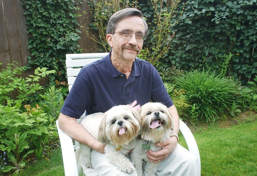 "News-Register file photo##Barry Lilly poses for a 2002 News-Register feature with his two shih-tzues, Katie and Rascal, who have since passed away but are ""still part of my life,"" Lilly says. He lives in McMinnville with his wife, Barbara."