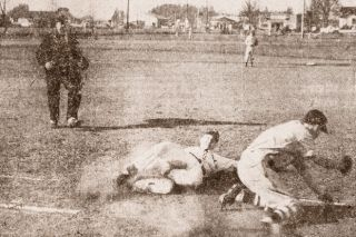 News-Register file photo##Dale Patton slides back into first base to thwart a Newberg pickoff attempt in the McMinnville baseball team's 2-0 loss to Newberg at Baker Field on April 4, 1952.