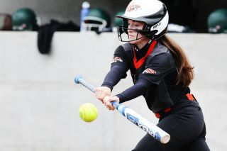 Rockne Roll/News-Register##Yamhill-Carlton pitcher Abbey Berhorst drops a bunt in the Tigers' game against North Marion on Wednesday, May 4, in Yamhill.