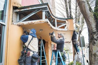 Marcus Larson/News-Register##Construction workers dismantled the old Gallery Theater sign piece by piece late last year so it could be remodeled with new siding and lettering.