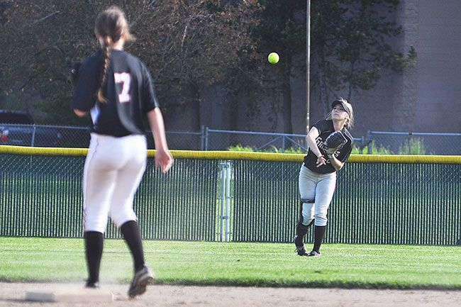 Robert Husseman/News-RegisterMcMinnville center fielder Jacinda Swiger (right) throws a ball into second baseman Josie Smith (7) off a Glencoe single Wednesday afternoon. Swiger and Smith combined for five of the Grizzlies' seven hits against the Crimson Tide.