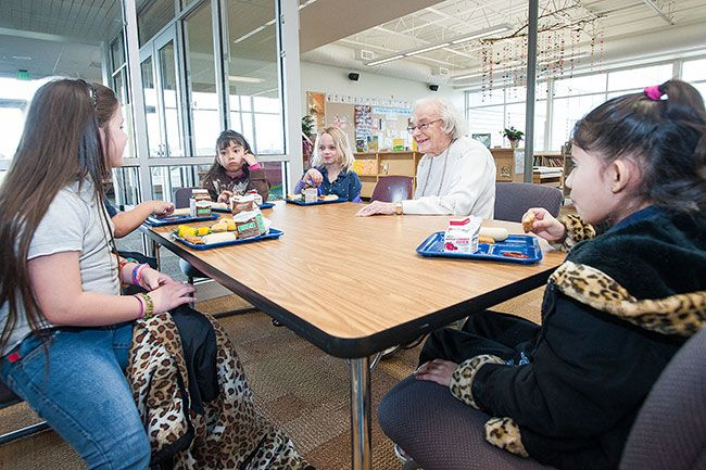 News-Register file photo##Students love having lunch with Sue Buel at her namesake school. Buel, who died Monday, visited the school once or twice a week.
