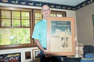 Robert Husseman/News-Register##Nick Robertson poses at his Portland home with a framed copy of the News-Register s March 12, 1979, front page commemorating the McMinnville boys basketball team s Class AAA state championship.