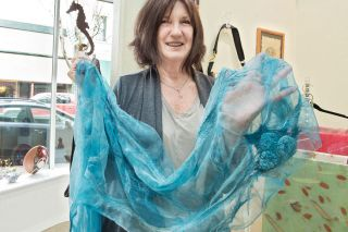 Marcus Larson/News-Register##Patti Bobonich displays a wool and silk scarf at Currents Gallery. She sells a selection of her work at the downtown McMinnville shop.