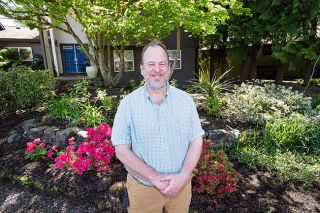 Marcus Larson/News-Register##Mark Cooley's low-maintenance landscape of trees, flowers and native plants was awarded the McMinnville Garden Club's Yard of the Month honors for May. Cooley says the garden is still a work in progress.