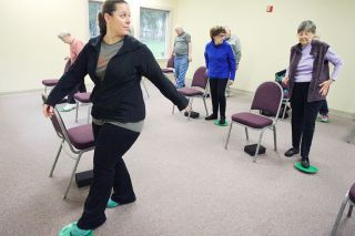 Rockne Roll/News-Register##Annette Clark, left, leads a Better Bones & Balance class at the McMinnville Senior Center. The class is based on research conducted by the OSU Bone Research Center.