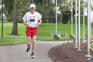 Rockne Roll/News-Register##Ted Gross, pictured here near the Oregon State Capitol in Salem, retired in 2013 from Chemeketa Community College's McMinnville campus. The veteran marathoner runs four miles two or three times during the week, and another 10 miles on Saturdays.